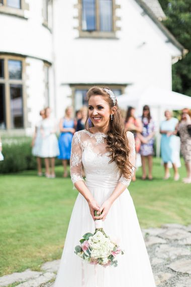 Bride in Lace Wedding Dress from Agape Bridal Boutique | Bouquet Toss