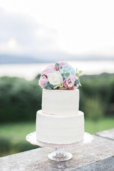 Elegant Two Tier Wedding Cake with Pastel Floral Cake Topper