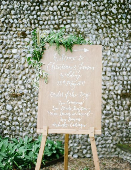 Wooden Order of The Day Sign | Classic Green & White Outdoor Country Wedding at Voewood in Norfolk, Planned & Styled by Vanilla Rose Weddings & Events | Julie Michaelsen Photography