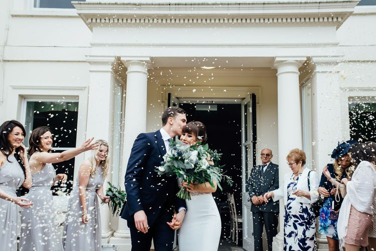 Confetti Moment | Bride in Illusion Back Martina Liana Bridal Gown | Groom in Gieves & Hawkes Suit | Modern Hall London | Beatrici Photography