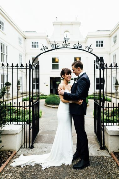 Bride in Illusion Back Martina Liana Bridal Gown | Groom in Gieves & Hawkes Suit | Modern Hall London | Beatrici Photography