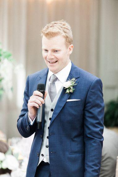 Groom in Reiss Navy Wedding Suit   Elegant Hampton Manor Wedding with Floral Decor   Xander & Thea Fine Art Wedding Photography