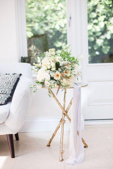 Romantic White & Peach Wedding Bouquet on Gold Legged Table   Elegant Hampton Manor Wedding with Floral Decor   Xander & Thea Fine Art Wedding Photography