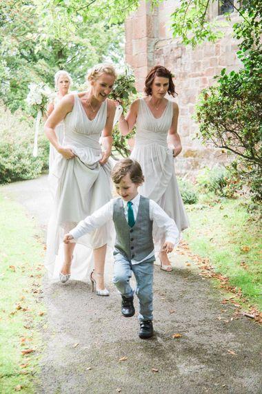 Bridesmaids in Grey Dessy Bridesmaid Dresses   Elegant Hampton Manor Wedding with Floral Decor   Xander & Thea Fine Art Wedding Photography