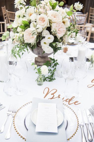 Clear Platter with Gold Edge Place Setting   Floral Centrepiece   Elegant Hampton Manor Wedding with Floral Decor   Xander & Thea Fine Art Wedding Photography
