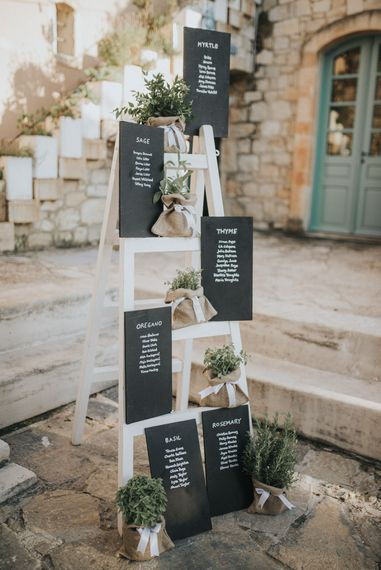 Step Ladder Herb & Chalkboard Table Plan | Outdoor Pastel Destination Wedding at Agreco in Greece | Best Moments Wedding Planner | Paulina Weddings Photography