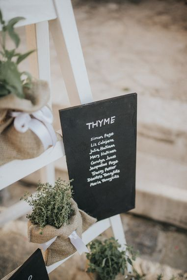 Minute Chalkboard Table Plan Sign | Outdoor Pastel Destination Wedding at Agreco in Greece | Best Moments Wedding Planner | Paulina Weddings Photography