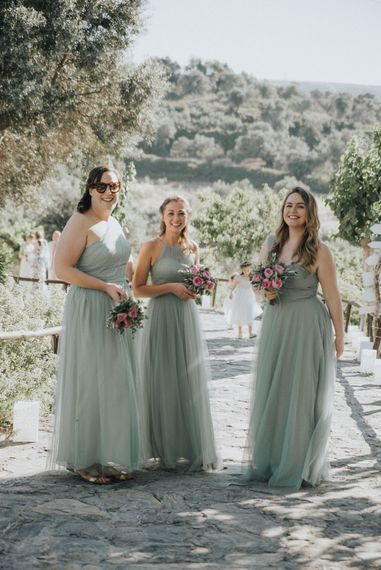 Bridesmaids in Pale Green For Her and For Him Gowns | Outdoor Pastel Destination Wedding at Agreco in Greece | Best Moments Wedding Planner | Paulina Weddings Photography