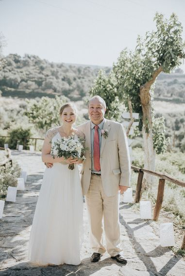 Bride in Catherine Deane Gown | Father of the Bride in Beige Austin Reed Suit | Outdoor Pastel Destination Wedding at Agreco in Greece | Best Moments Wedding Planner | Paulina Weddings Photography