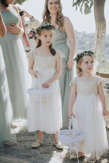 Flower Girls in Monsoon | Bridesmaids in Pale Green For Her and For Him Gowns | Outdoor Pastel Destination Wedding at Agreco in Greece | Best Moments Wedding Planner | Paulina Weddings Photography