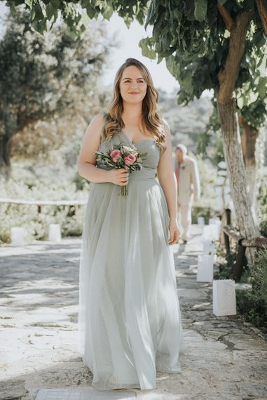 Bridesmaid in Pale Green For Her and For Him Chiffon Dress | Outdoor Pastel Destination Wedding at Agreco in Greece | Best Moments Wedding Planner | Paulina Weddings Photography