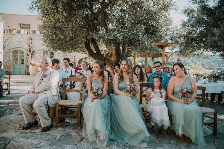 Wedding Ceremony | Bridesmaids in Pale Green For Her and For Him Gowns | Outdoor Pastel Destination Wedding at Agreco in Greece | Best Moments Wedding Planner | Paulina Weddings Photography
