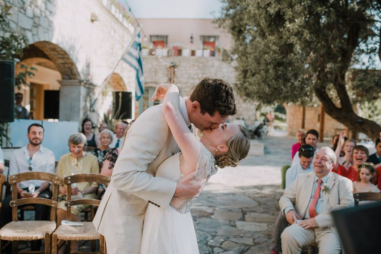 Wedding Ceremony | Bride in Catherine Deane Gown | Groom in Beige Austin Reed Suit | Outdoor Pastel Destination Wedding at Agreco in Greece | Best Moments Wedding Planner | Paulina Weddings Photography