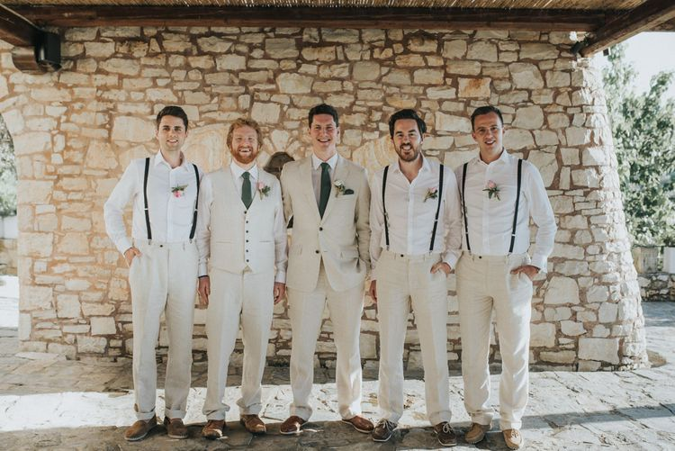 Groomsmen in Beige Austin Reed Suits | Outdoor Pastel Destination Wedding at Agreco in Greece | Best Moments Wedding Planner | Paulina Weddings Photography