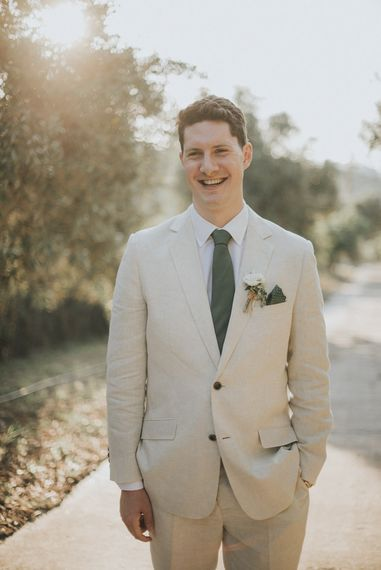 Groom in Beige Austin Reed Suit | Outdoor Pastel Destination Wedding at Agreco in Greece | Best Moments Wedding Planner | Paulina Weddings Photography