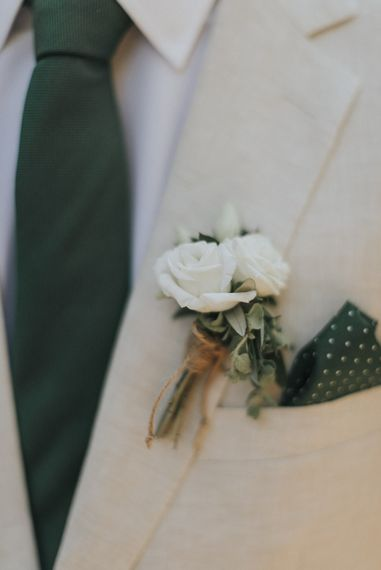 Delicate White Flower Buttonhole | Outdoor Pastel Destination Wedding at Agreco in Greece | Best Moments Wedding Planner | Paulina Weddings Photography