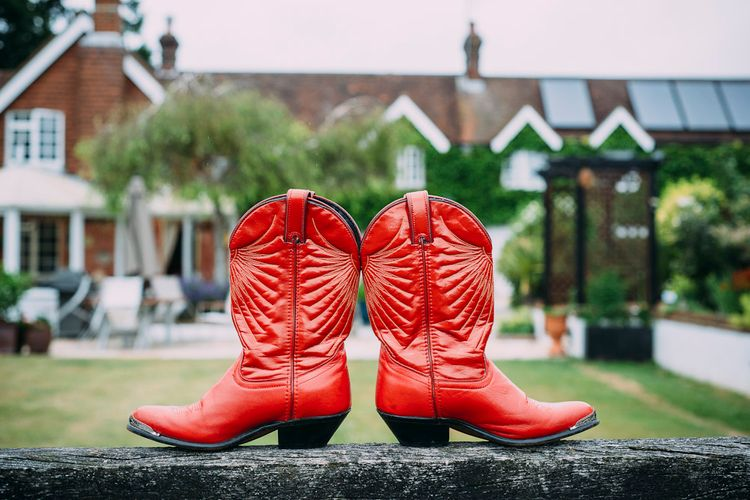 Red Cowboy Boot Wedding Shoes | Rustic Wedding at Yoghurt Rooms in Sussex | Louise Griffin Photography