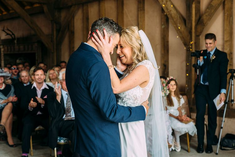 Wedding Ceremony | Bride in Ivy & Aster Gown | Groom in Reiss Suit | Rustic Wedding at Yoghurt Rooms in Sussex | Louise Griffin Photography