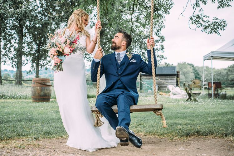 Bride in Ivy & Aster Bridal Gown | Groom in Navy Reiss Suit | Rustic Wedding at Yoghurt Rooms in Sussex | Louise Griffin Photography