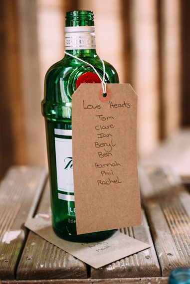 Wine Bottle & Craft Tag Table Plan | Rustic Wedding at Yoghurt Rooms in Sussex | Louise Griffin Photography