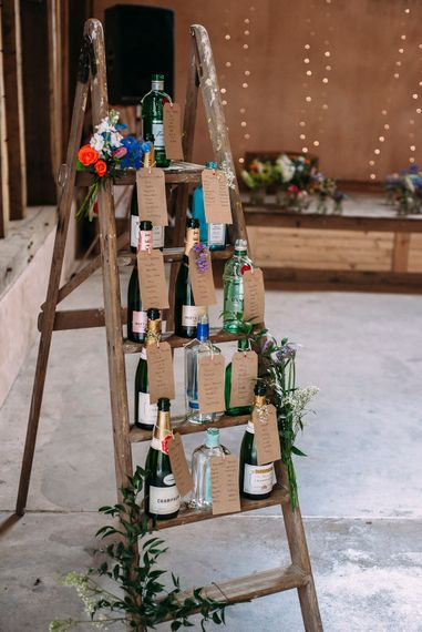 Vintage Step Ladder with Wine Bottle Table Plan | Wedding Decor | Rustic Wedding at Yoghurt Rooms in Sussex | Louise Griffin Photography