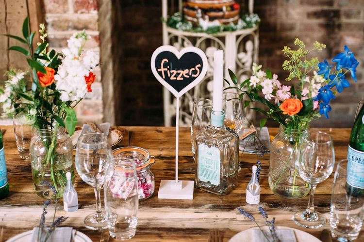 Sweet Table Names | Flower Stems in Bottles & Jars | Wedding Decor | Rustic Wedding at Yoghurt Rooms in Sussex | Louise Griffin Photography