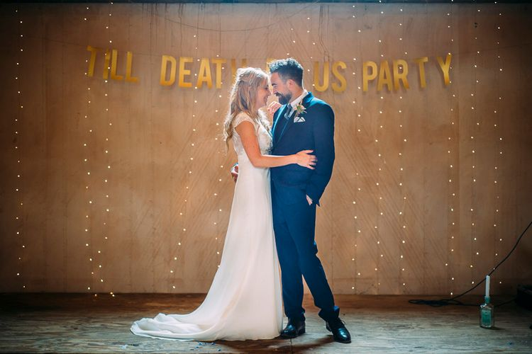 Bride in Ivy & Aster Gown | Groom in Reiss Suit | Till Death Us Do Party Banner | Rustic Wedding at Yoghurt Rooms in Sussex | Louise Griffin Photography