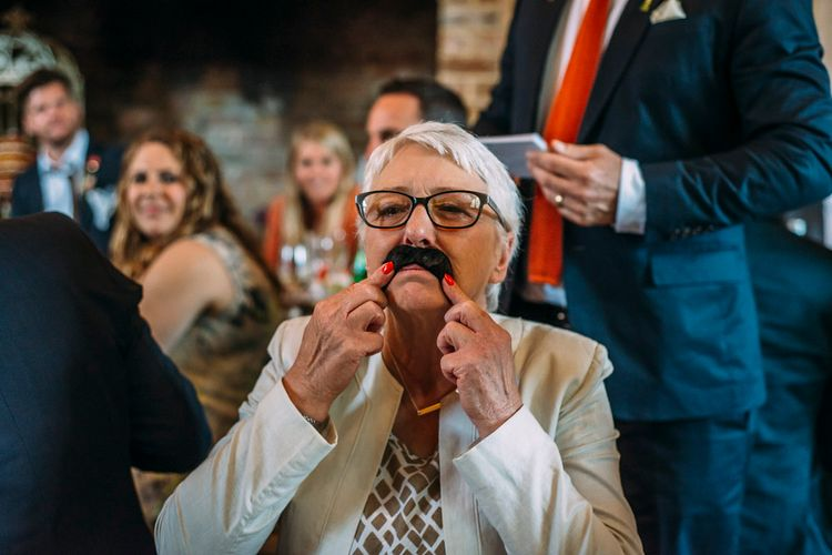 Fake Moustache | Wedding Guests | Rustic Wedding at Yoghurt Rooms in Sussex | Louise Griffin Photography