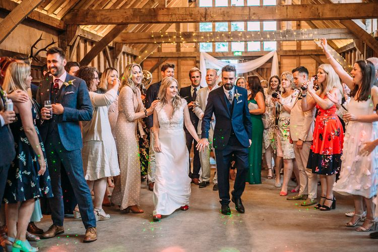 First Dance | Bride in Ivy & Aster Secret Garden Wedding Dress | Groom in Navy Reiss Suit | Rustic Wedding at Yoghurt Rooms in Sussex | Louise Griffin Photography