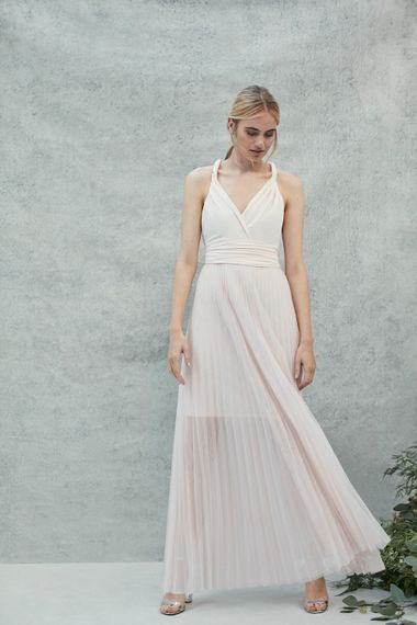 "<a href=""https://www.coast-stores.com/p/corwin-tulle-maxi/1903765?utm_source=Rock_my_wedding&utm_medium=social&utm_campaign=blog_post&utm_content=corwindress"" rel=""noopener"" target=""_blank"">Corwin Tulle Maxi</a> by Coast"