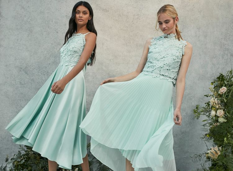 "<a href=""https://www.coast-stores.com/p/janie-lace-midi-dress/1875165?utm_source=Rock_my_wedding&utm_medium=social&utm_campaign=blog_post&utm_content=janiedress"" rel=""noopener"" target=""_blank"">Janie Lace Dress</a>, <a href=""https://www.coast-stores.com/p/izel-lace-top/1875252?utm_source=Rock_my_wedding&utm_medium=social&utm_campaign=blog_post&utm_content=izeltop"" rel=""noopener"" target=""_blank"">Izel Lace Top</a> & <a href=""https://www.coast-stores.com/p/amelia-bridesmaid-skirt/1902652?utm_source=Rock_my_wedding&utm_medium=social&utm_campaign=blog_post&utm_content=ameliaskirt"" rel=""noopener"" target=""_blank"">Amelia Skirt</a> by Coast"