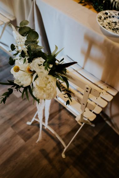 Floral Chair Back Decor | Chic Rustic French Wedding at Le Morimont Styled by Féelicité | Photography by Chloe