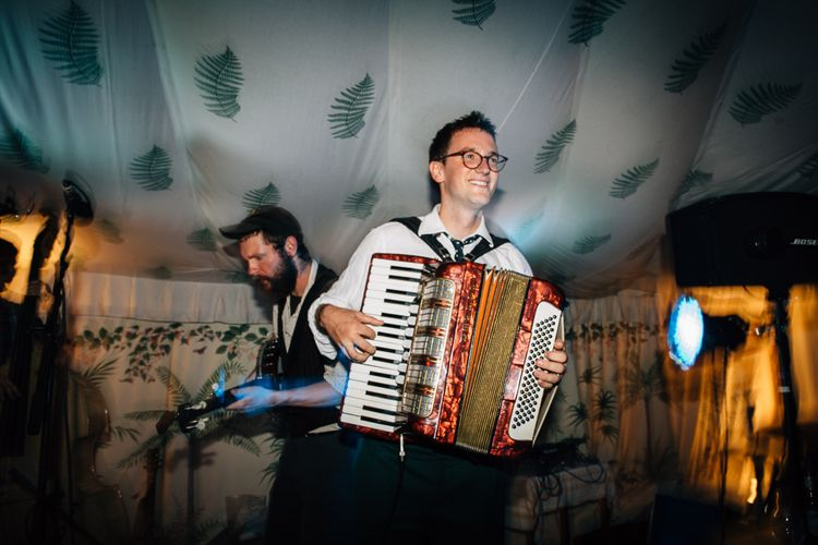 Groom Playing The Accordian