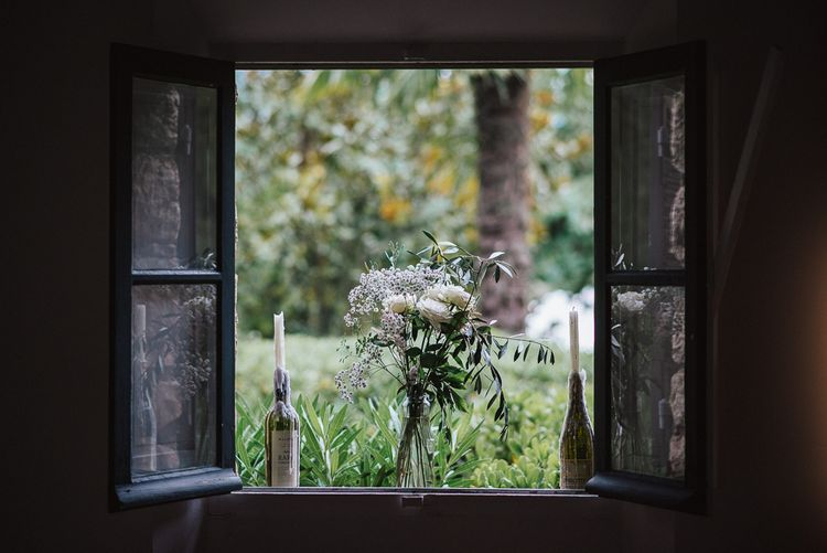 Flower Stems in Glass Bottle Wedding Decor