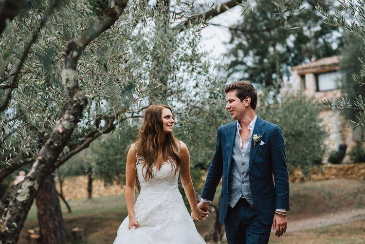 Bride in Pronovias Wedding Dress & Groom in Suit Supply