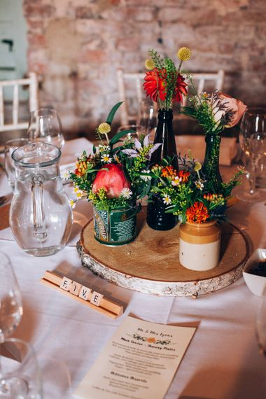 Rustic Tree Slice Centrepiece with Flower Stems in Jars & Vases