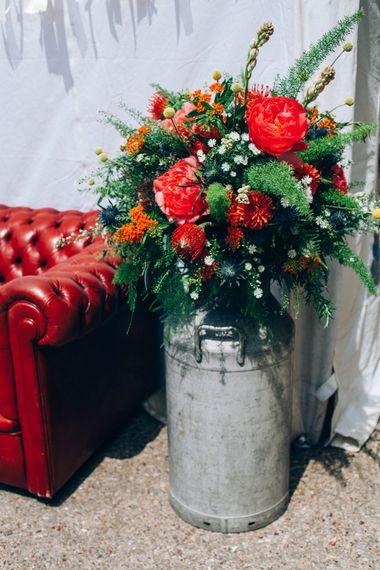 Milk Urn filled with Bright Florals