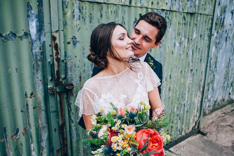 Bride in David Fielden Wedding Dress & Groom in Reiss Suit