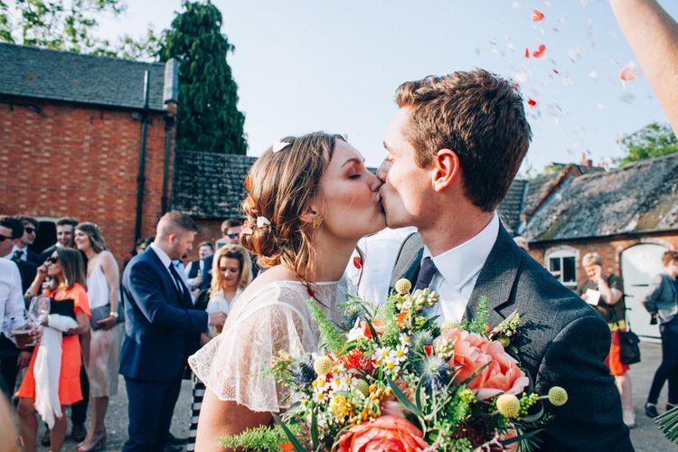 Confetti Moment with Bride in David Fielden Wedding Dress & Groom in Reiss Suit
