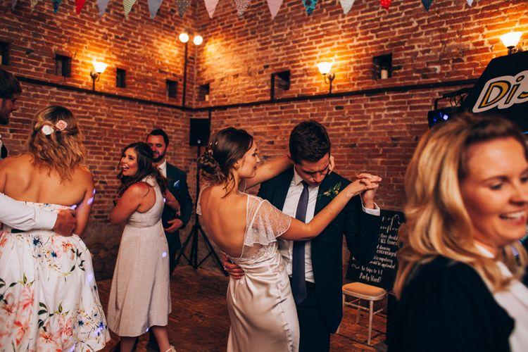 Evening Reception with Bride in David Fielden Wedding Dress & Groom in Reiss Suit