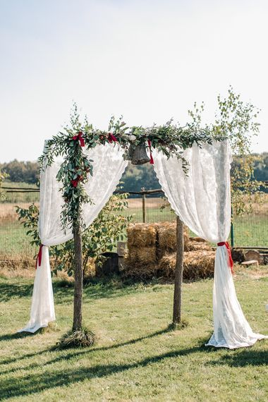 Outdoor Rustic Altar with Curtains & Floral Garland