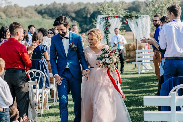 Outdoor Wedding Ceremony with Bride in Bespoke Pink Tulle Gown & Groom in Vitale Barberis Canonico Suit