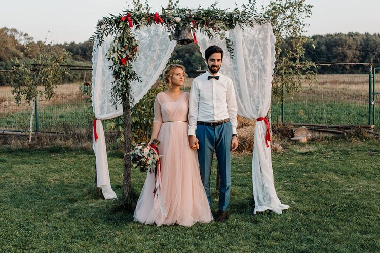 Outdoor Altar with Bride in Bespoke Pink Tulle Gown & Groom in Vitale Barberis Canonico Suit