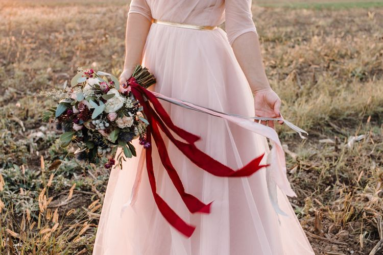 Bride in Bespoke Pink Tulle Gown & Autumnal Bouquet with Ribbons