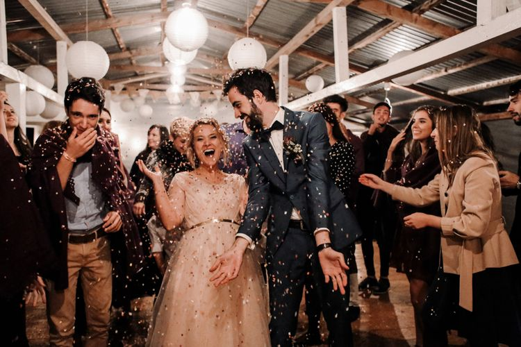Confetti Moment with Bride in Bespoke Pink Tulle Gown & Groom in Vitale Barberis Canonico Suit