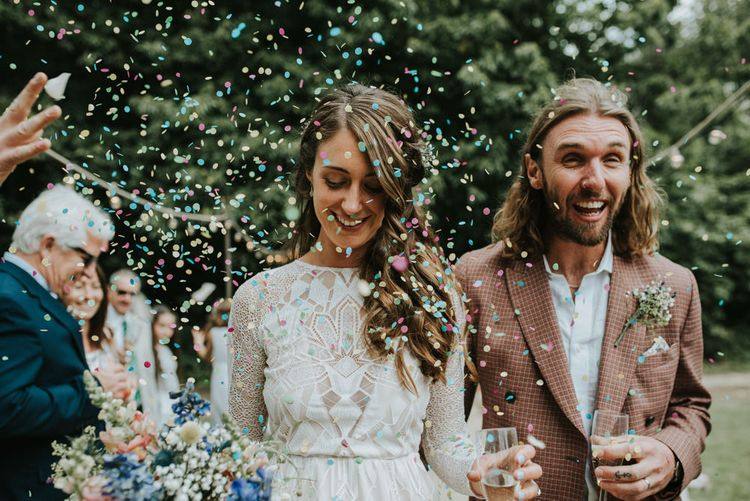 Confetti Moment | Bride in Grace Loves Lace | Groom in Brown Check Suit | Outdoor Woodland Wedding at The Dreys in Kent | Fern Edwards Photography
