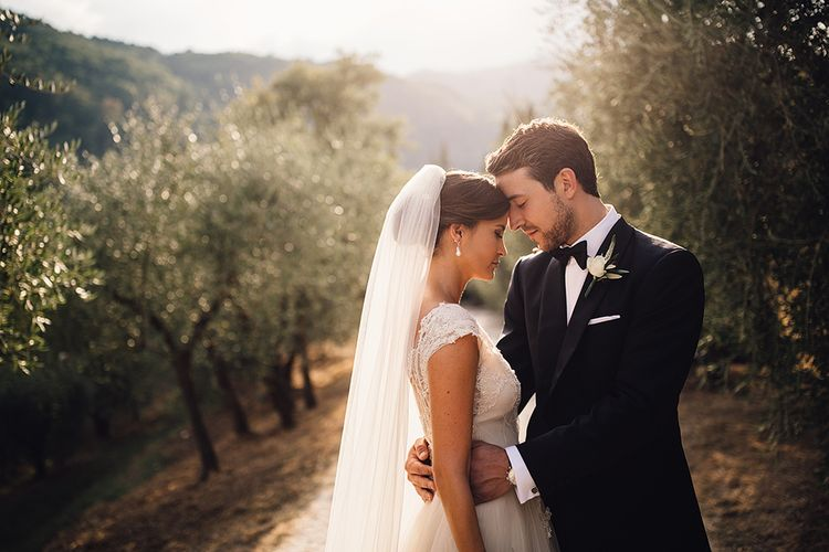 Bride in Customised David Fielden Wedding Dress and Groom in Cad & The Dandy Suit Sunset Portrait