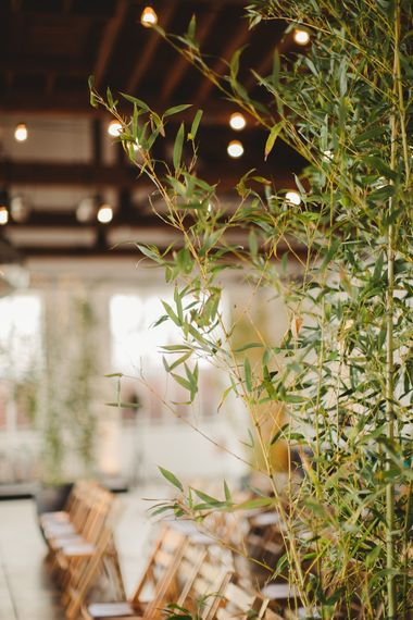 Warehouse Wedding With Wooden Chairs & Foliage Installation | Images by Frances Sales