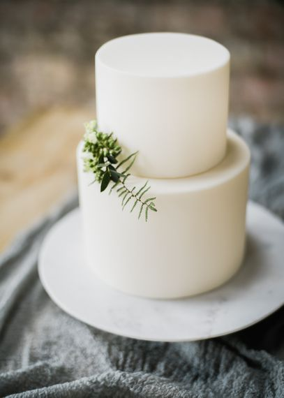 Elegant White Wedding Cake With Foliage
