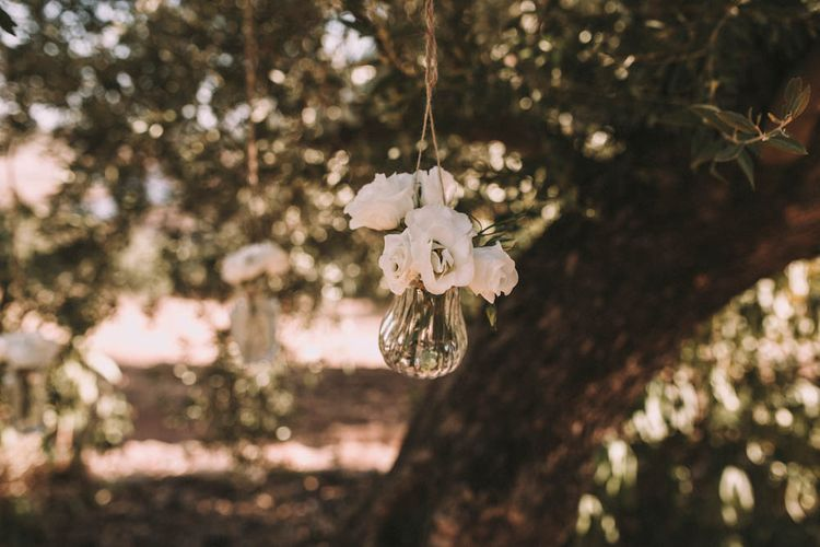 Hanging Vases Filled with Flowers